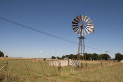 Farm Windmill. Farming Windmill stands motionless on a sunny day Royalty Free Stock Photos
