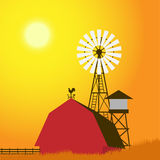 Farm windmill, barn, fence, house Stock Photography