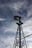 Farm windmill cloudy day Royalty Free Stock Photos