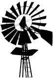 Farm Windmill Silhouette. Silhouette of a water pumping windmill Stock Photos