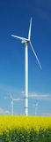Farm of windturbines close to field Stock Image