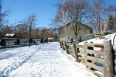 Farm in the Winter. A snowy pathway leading to a farm Stock Photos