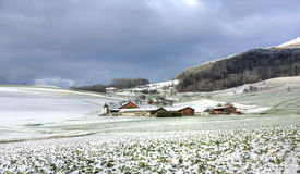 Farm in winter. Scene, Switzerland (HDR version Royalty Free Stock Photo