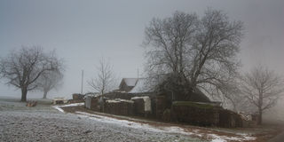 Farm in winter. Old farm on a gray winter day Royalty Free Stock Photography