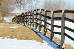Farm in winter. Farm fence and lines of shadows in winter time Royalty Free Stock Photo