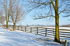 Farm in winter. Farm fence and lines of shadows in winter time Stock Photography
