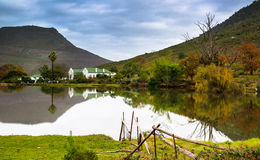 Farm in winter. Franschhoek started out as a farm community. the houses is built in the Dutch style of the 1700. Some of the best wines in South Africa is found Royalty Free Stock Photos