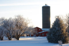 Farm in Winter. With red barn, and silo Royalty Free Stock Photography