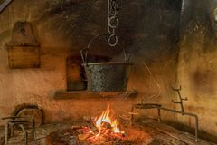 Farm and Winter Sports Museum, Schliersee, Bavaria. Cooking pot over the fire in a farmhouse in the Markus Wasmeier Farm and Winter Sports Museum, Schliersee Royalty Free Stock Photography