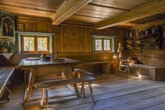 Farm and Winter Sports Museum, Schliersee, Bavaria. Farmhouse sitting room in the Markus Wasmeier Farm and Winter Sports Museum, Schliersee, Upper Bavaria Royalty Free Stock Photo