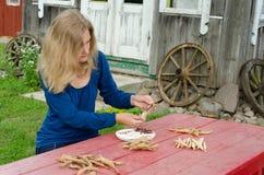 Farm woman shell various kind decorative beans Stock Photos