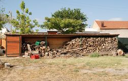 Farm Wood Stockpile. A stockpile of wood under cover in a wooden shelter on a farm Stock Photo