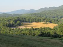 Farm in wooded clearing in Vermont Royalty Free Stock Photography