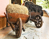 Farm Wooden Wheelbarrows Stock Images