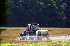 Farm Worker. A farmer spraying his fields in preparation for planting Royalty Free Stock Image