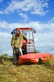 Farm worker with tractor Royalty Free Stock Photos