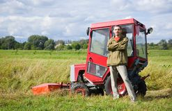 Farm worker with tractor Stock Photo