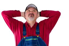 Farm worker wearing dungarees on white background. Thoughtful farm worker wearing dungarees against white background Stock Photos