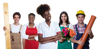 Farmacista femminile afroamericano con il gruppo di arabo e di lati Fotografia Stock Libera da Diritti