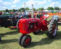 Farmall-C red antique farming tractor. Stock Photo