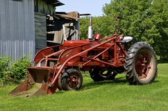 Farmall M tractor with front end loader Stock Images
