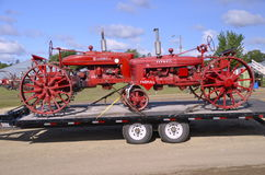 Farmall tractors arrive at threshing reunion. DALTON, MN, September 14, 2015: Restored Farmall tractors arrive at the Dalton Threshing Reunion where 1000s Royalty Free Stock Photo