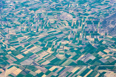 Farmed fields aerial view landscape Stock Photos