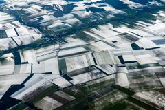 Farmed fields covered by snow aerial panorama Stock Image