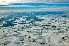 Europe france winter farmed fields covered by snow aerial panorama. Farmed fields covered by snow aerial view landscape in europe France ice cold winter Royalty Free Stock Photos