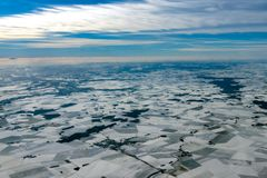 Europe france winter farmed fields covered by snow aerial panorama. Farmed fields covered by snow aerial view landscape in europe France ice cold winter Stock Image