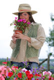 Farmer. Attractive young woman shopping for flowers at the farmers market Royalty Free Stock Image