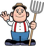 Farmer. A farmer with a pitch fork waving and smiling Royalty Free Stock Photos
