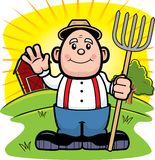 Farmer. A farmer with a pitch fork on a farm in the morning Stock Photo
