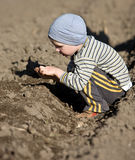 Farmer. A young farmer sowing on the field Royalty Free Stock Photography