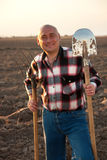 Farmer with agricultural tools royalty free stock photography
