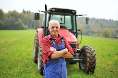 Free Farmer And His Red Tractor Royalty Free Stock Photo - 29799325