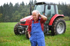 Free Farmer And His Red Tractor Royalty Free Stock Photo - 29799415