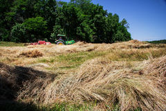 Farmer Bales Hay' Royalty Free Stock Photography