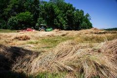 Farmer Bales Hay' Royalty Free Stock Photography