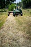 Farmer Bales Hay' Stock Photo
