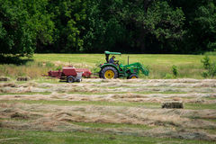 Farmer Bales Hay Royalty Free Stock Images
