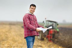 Farmer with bank forms Stock Images