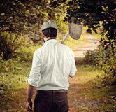 Farmer from behind in country side. Royalty Free Stock Image