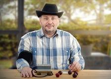 Farmer in black hat takes blood pressure Stock Photo