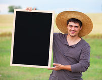 Farmer with blackboard Stock Photos