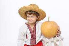 Farmer boy with a pumpkin Stock Image