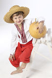 Farmer boy with a pumpkin Royalty Free Stock Photo