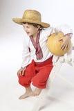 Farmer boy with a pumpkin Royalty Free Stock Image