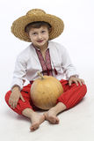 Farmer boy with a pumpkin Stock Photography