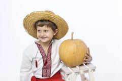 Farmer boy with a pumpkin Stock Photography